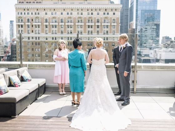 Wedding ceremony taking place on the rooftop