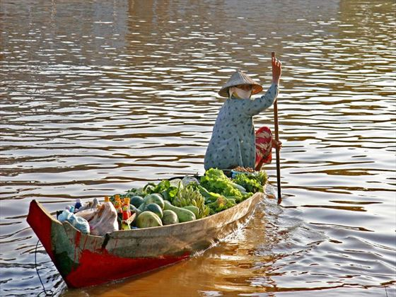 Woman boating on the Mekong Delta