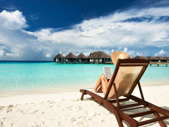 Relax and take in the views from a tranquil beach in the Maldives
