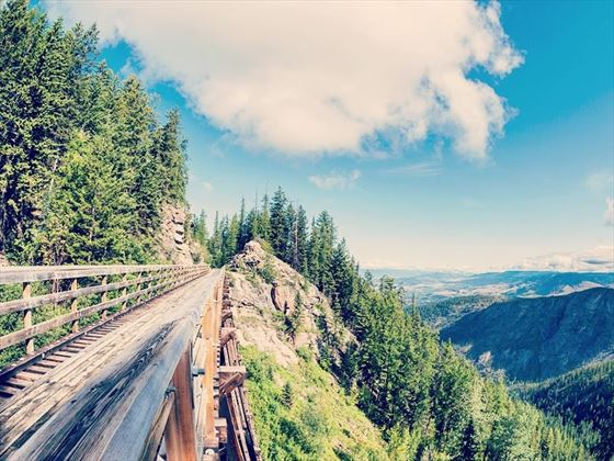 Wooden trestle in Myra Canyon, BC with views across the Okanagan Valley