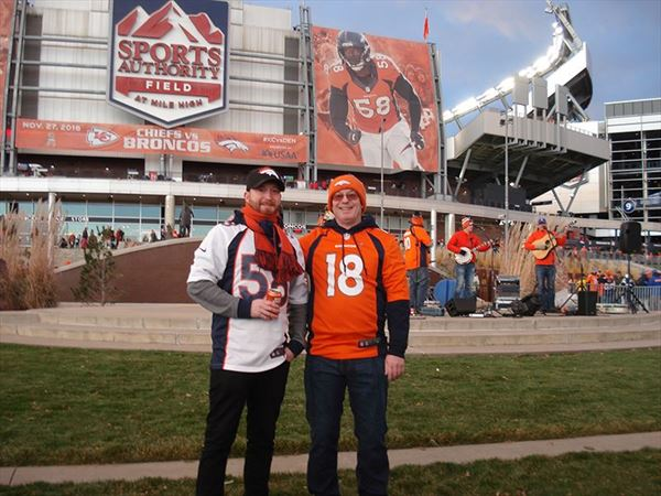 paul and philip outside sports authority field colorado