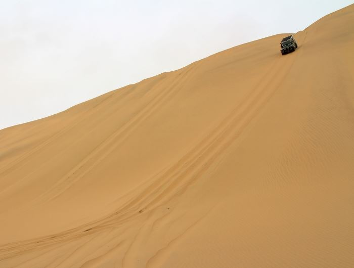4x4 drive on sand dunes - getty