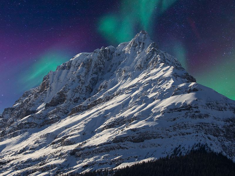 aurora over banff mountain top