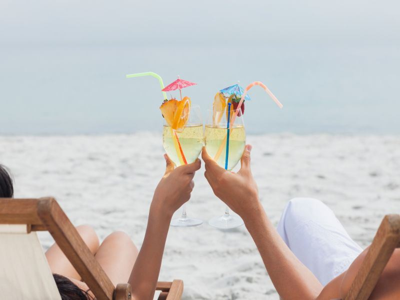 couples cocktails on the beach