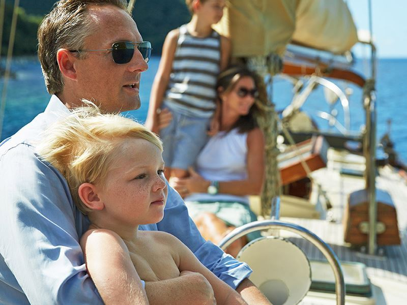Family sailing in the waters by Sugar Beach by Viceroy
