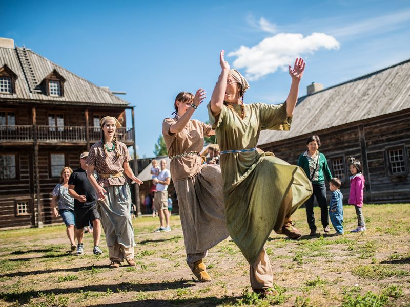 historical actors dancing at fort edmonton park