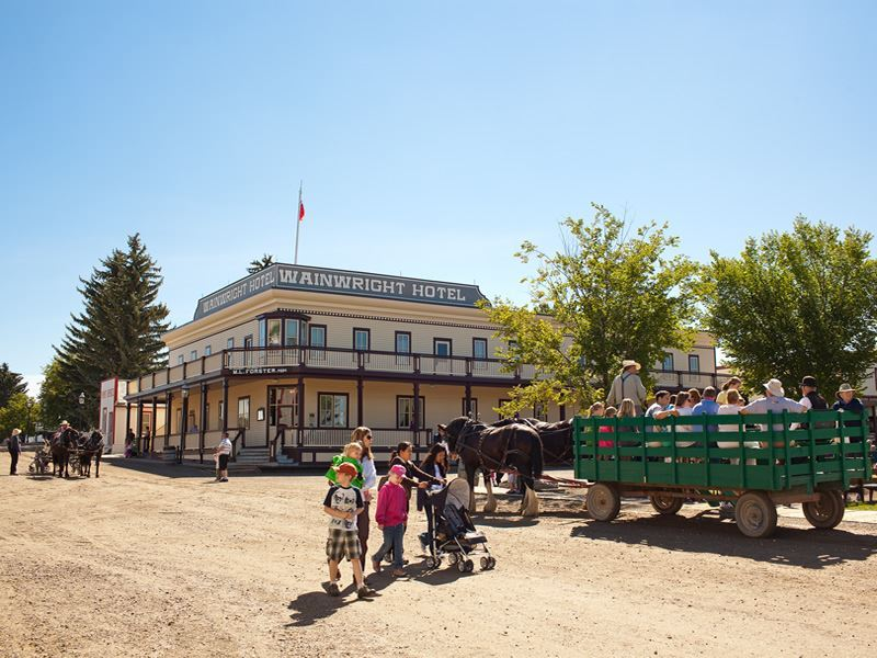 horse wagon ride in front of the wainwright hotel