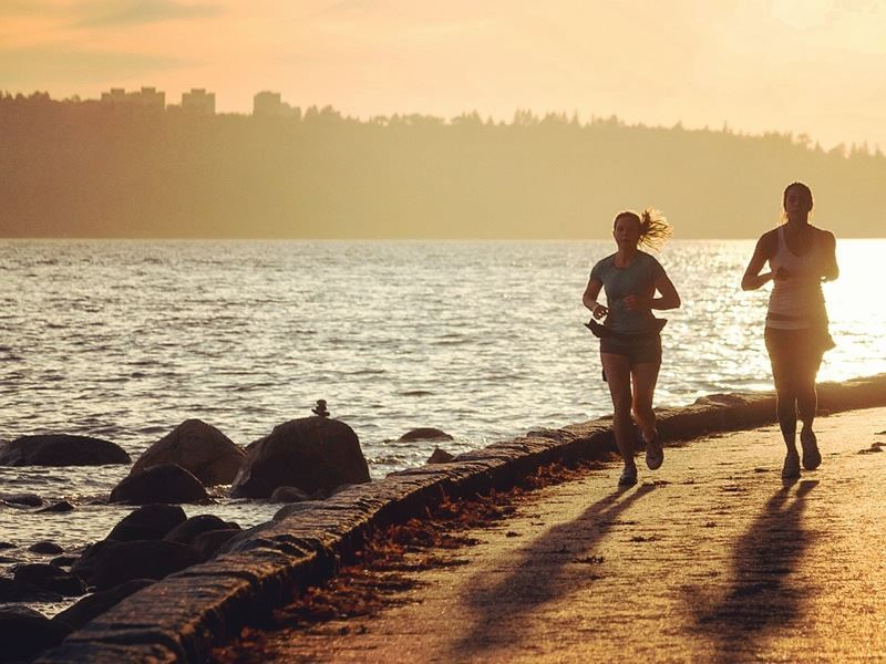 jogging along vancouver seawall at sunset