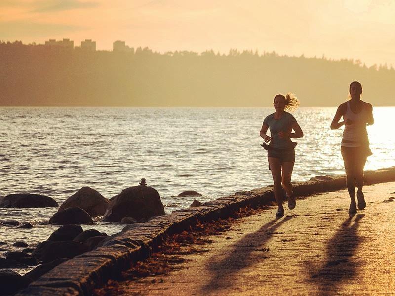 jogging along vancouver seawall at sunset