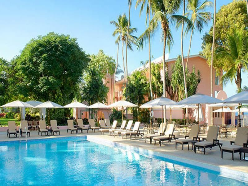 outdoor swimming pool and sun terrace at the fairmont royal pavilion