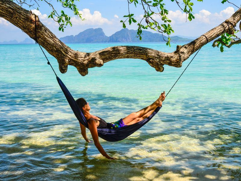 Relax on a hammock surrounded by tropical scenery