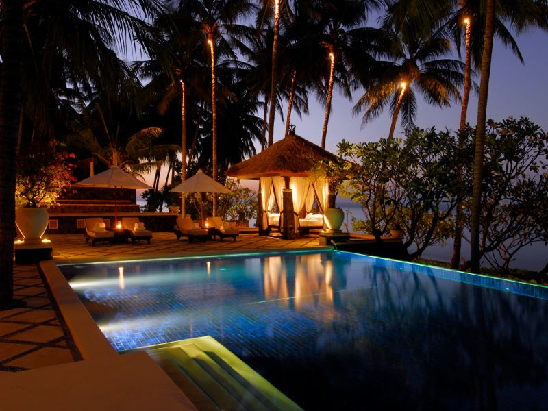 spa village resort tembok pool at night