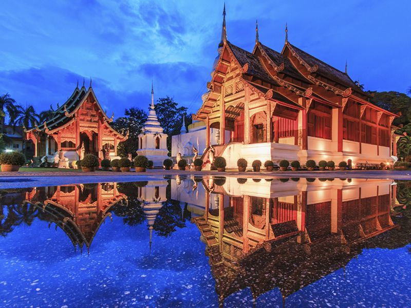 wat phra sing water reflection chiang mai province asia thailand