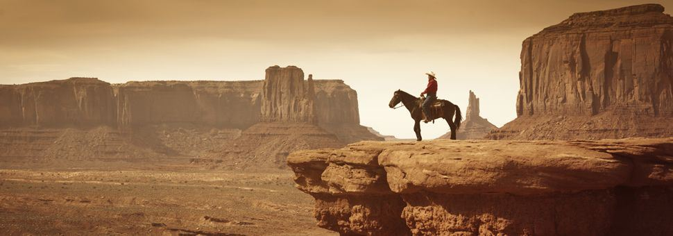 Cowboy overlooking Monument Valley Tribal Park, Arizona